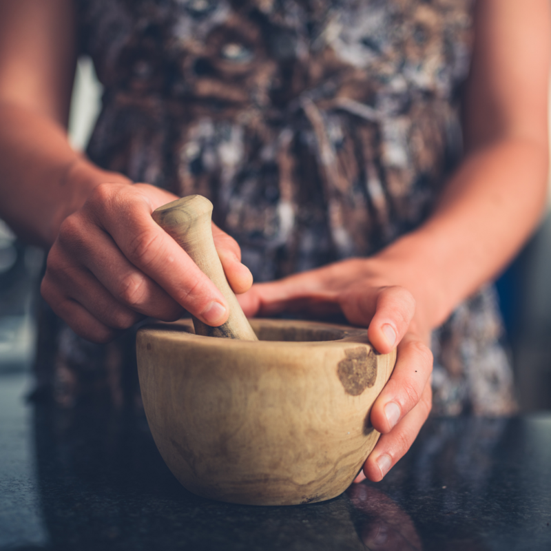 Hands holding mortar and pestle