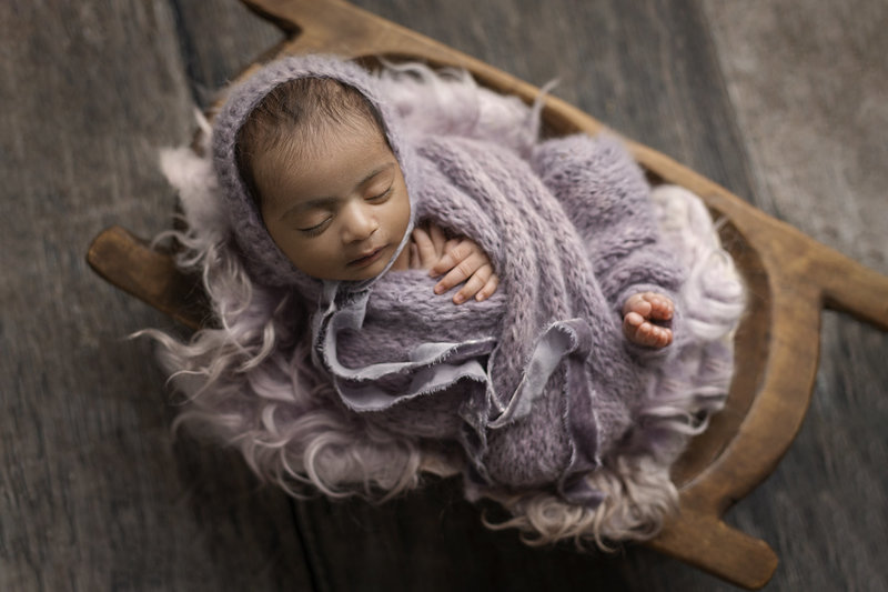 columbus ohio newborn photographer baby girl wrapped in lavendar knit swaddle
