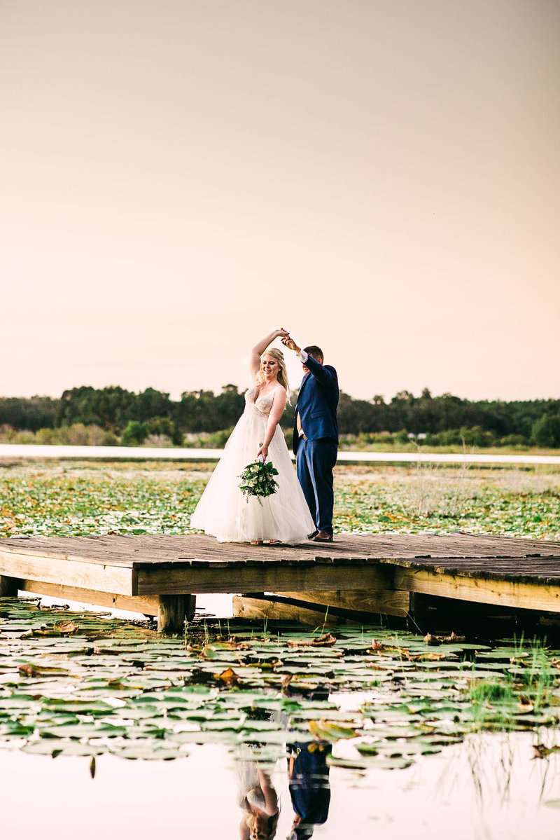 Bride and Groom on floating dock surrounded by lilly pads in salt springs Flrorida
