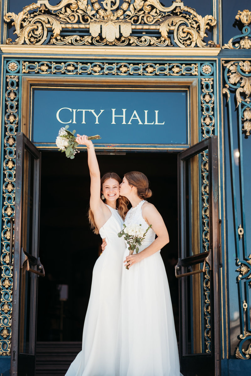 Two Brides in front of City Hall Doors iconic doors LGBTQ friendly city hall wedding photographer