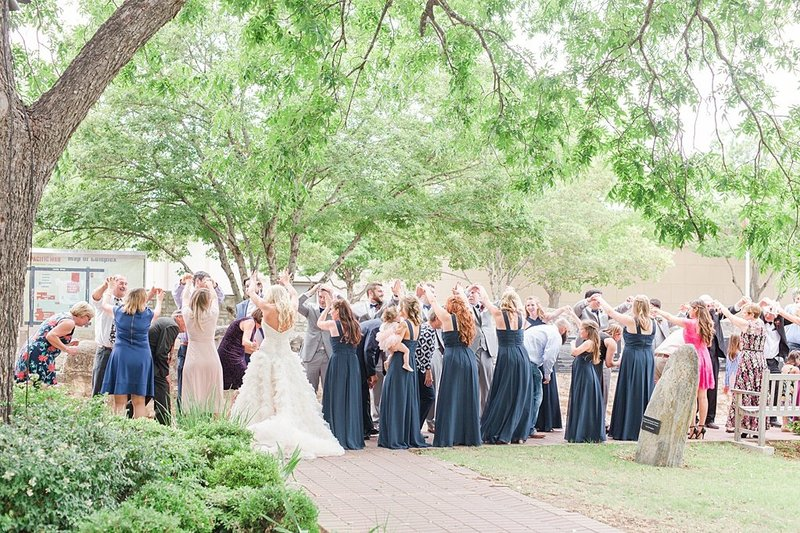 Wedding Ceremony at St Marys catholic church in Fredericksburg Texas and reception at National Museum of the Pacific war Nimitz in fredericksburg Texas Wedding Venue photos by Allison Jeffers Photography_0063