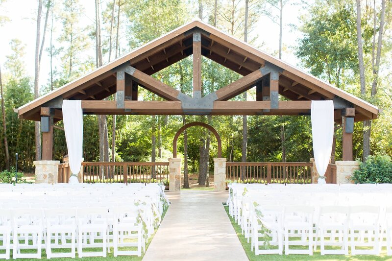 outdoor-wedding-ceremony-white-chairs-eucalyptus
