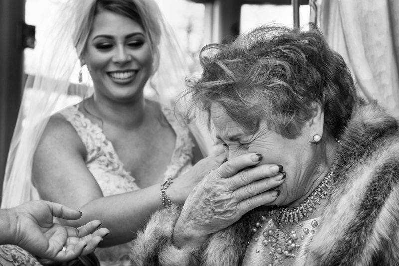 Black and white emotional wedding image of grandmother seeing  her granddaughter  in her wedding dress for the first time. Photo taken by Weddings BY Lee Photography a DC wedding photographer.
