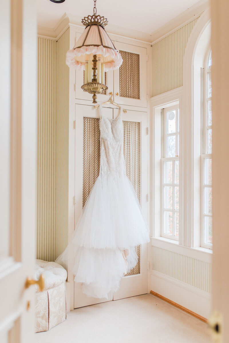 brides dress hanging  at great marsh estate wedding in charlottesville virginia by costola photography