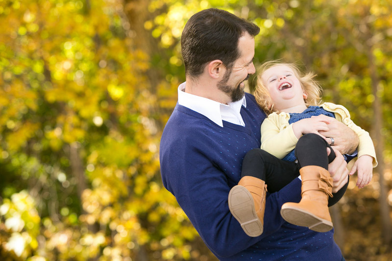 Dad and daughter having a fun time during photo session