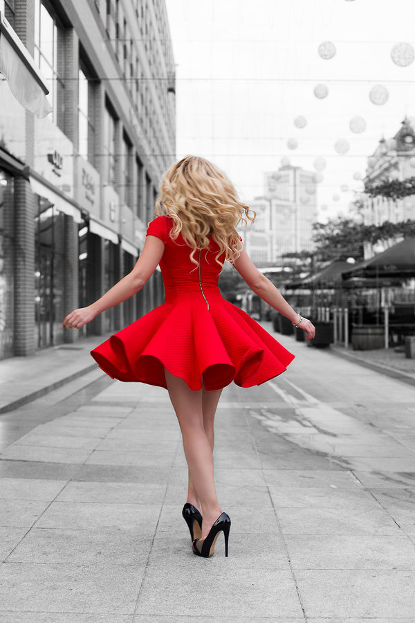 stock photo - blonde woman red dress nyc