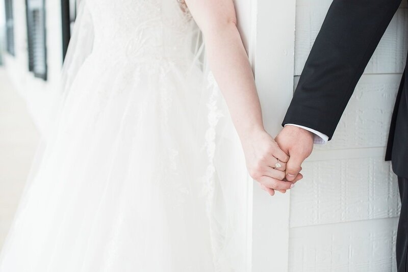 Bride and groom hold hands before wedding ceremony