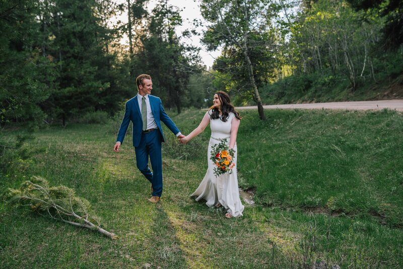 bride and groom happily walking in knoxville tn