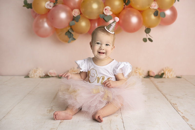 columbus ohio baby photographer first birthday blush and gold cake smash amanda estep photography