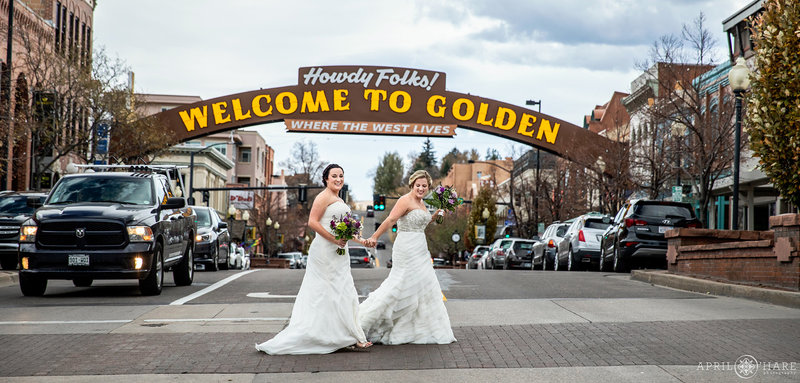 Brides under the historic Welcome to Golden Arch at The Golden Hotel in Colorado