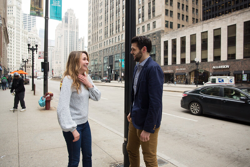 woman gasping after surprise proposal woman gasping from surprise engagement downtown chicago mag mile