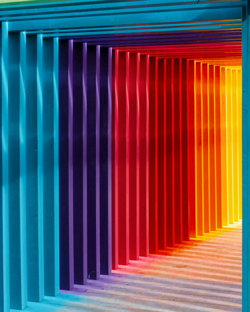 A multicoloured immersive art installation tunnel for a brand event