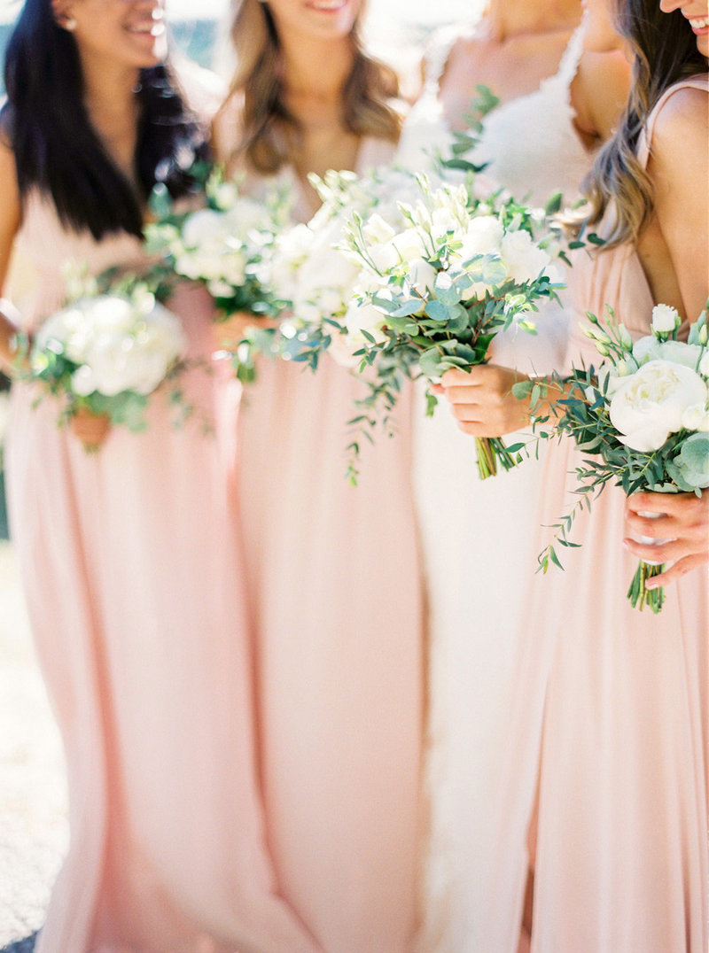 Bridesmaids group shot with flowers