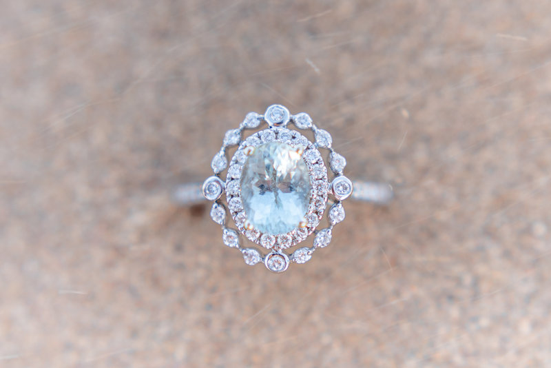 aquamarine wedding ring in sand