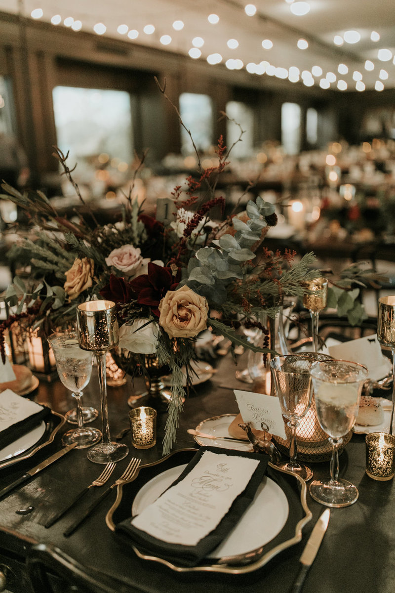 Moody and dark wedding reception table setting for a New Years Eve wedding at the Natural History Museum in Los Angeles