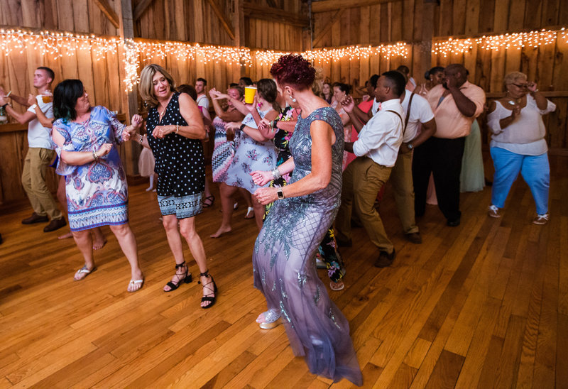 Guests dance at Betsy's Barn wedding reception