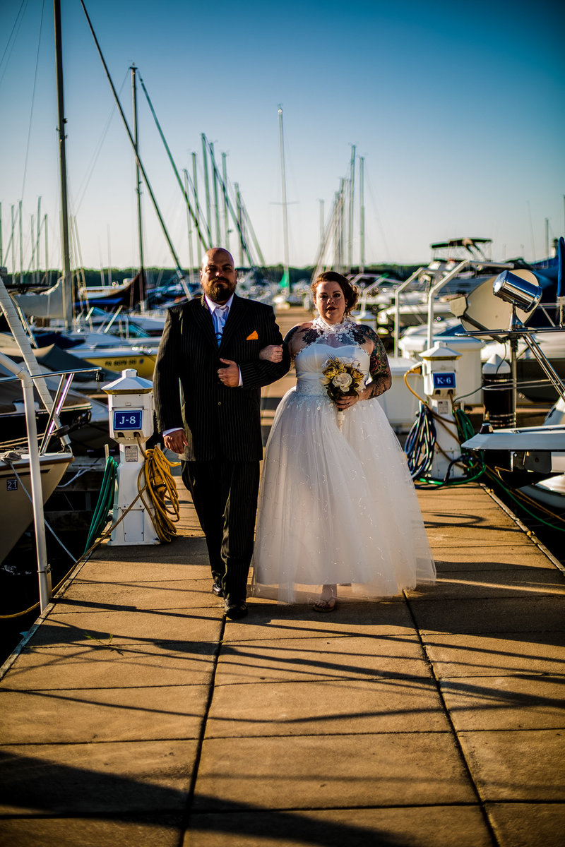 Couple poses on the transient dock at the Erie Yacht Club