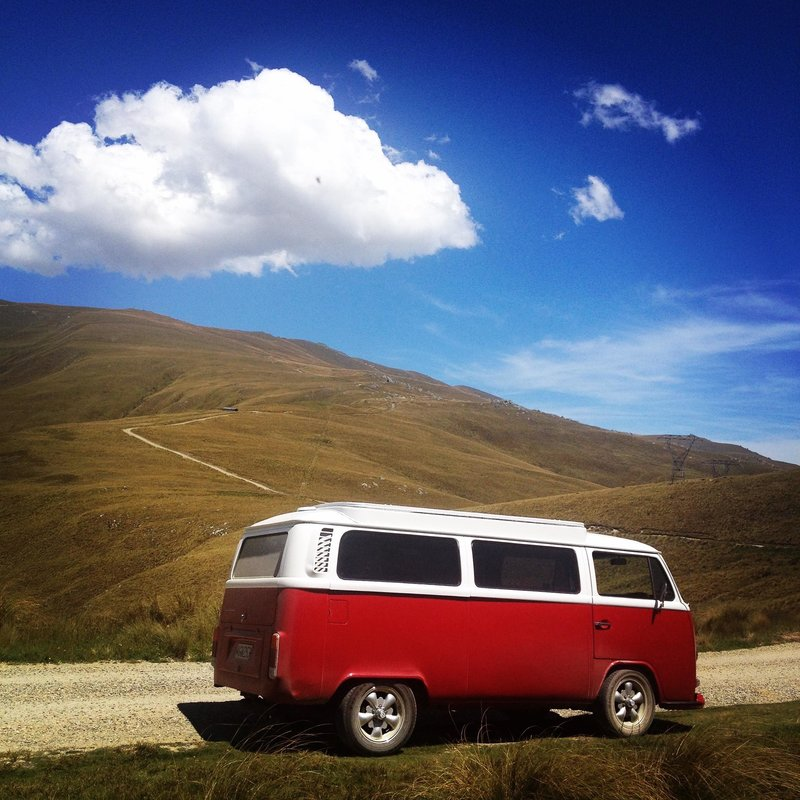 Aggiee, red kombi van sitting on the roadside of Dansey's Pass, central South Island of New Zealand
