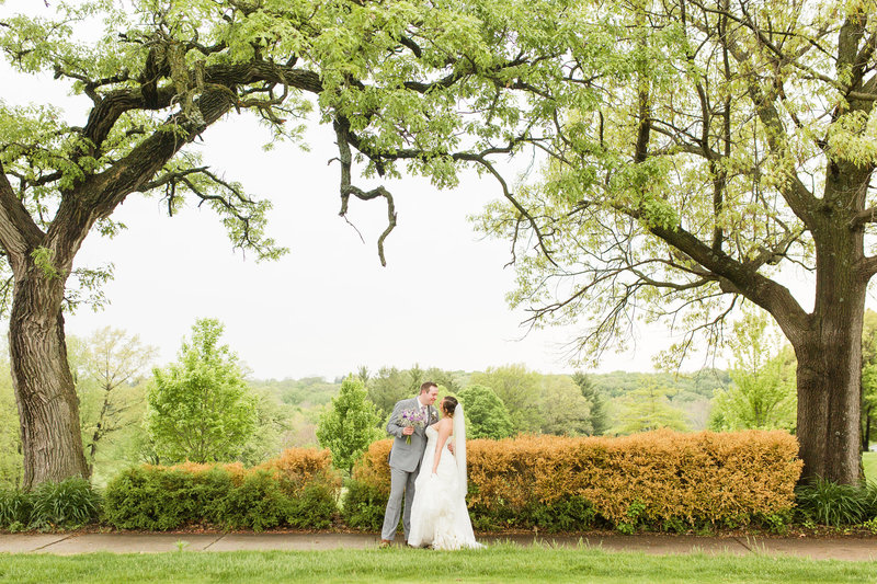 Bride and Groom Portrait at golf course| Megan Snitker Photography | Iowa City Wedding Photographers