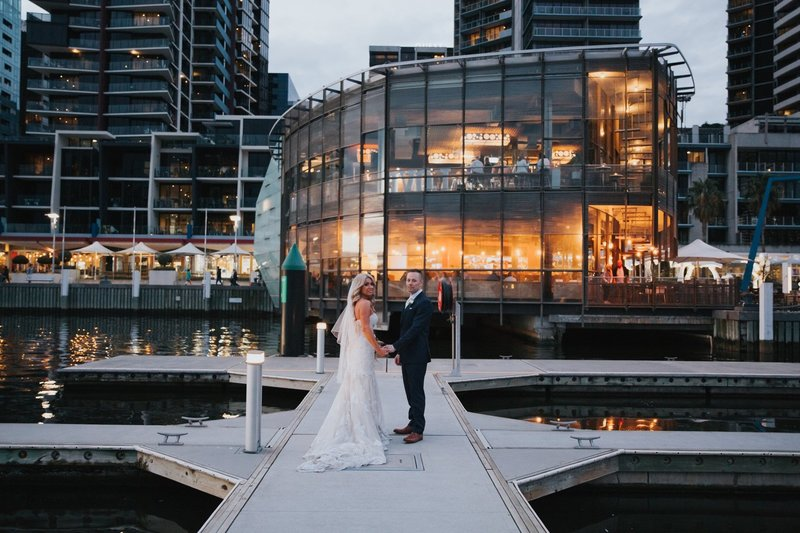 Just Married Couple taking Photos at Melbourne Docklands on Pier