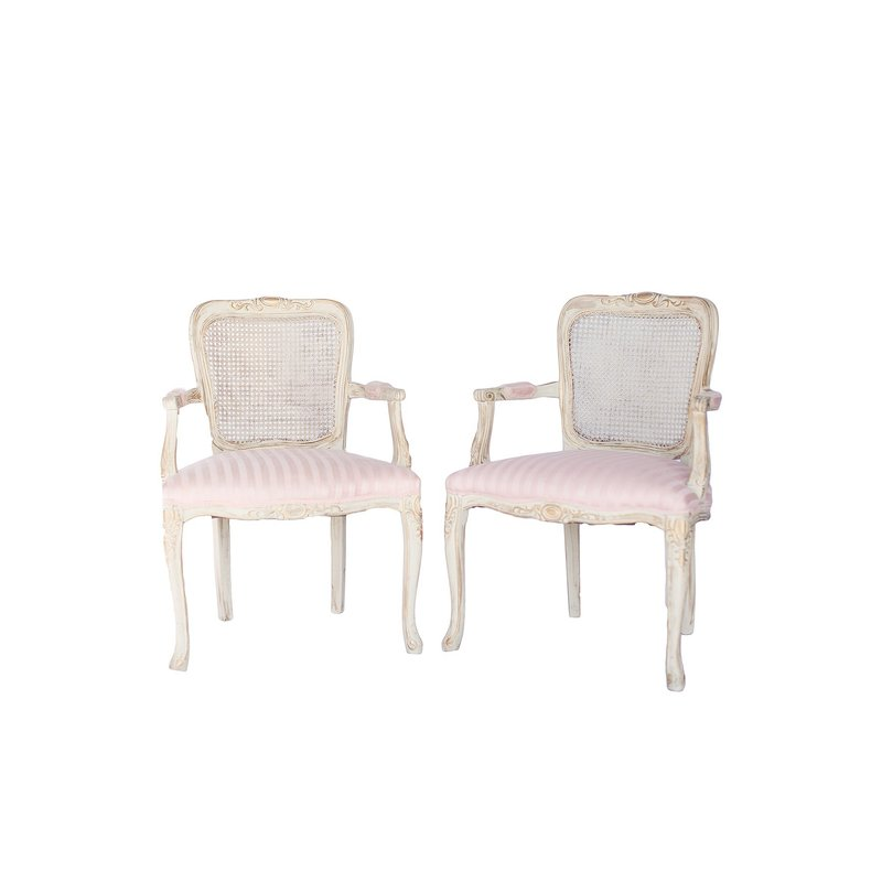 Vintage cane-back chair with gold accents. Upholstered in light pink striped fabric.