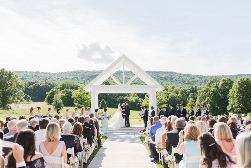 ceremony by the mountains at springfield manor winery and distillery wedding by costola photography