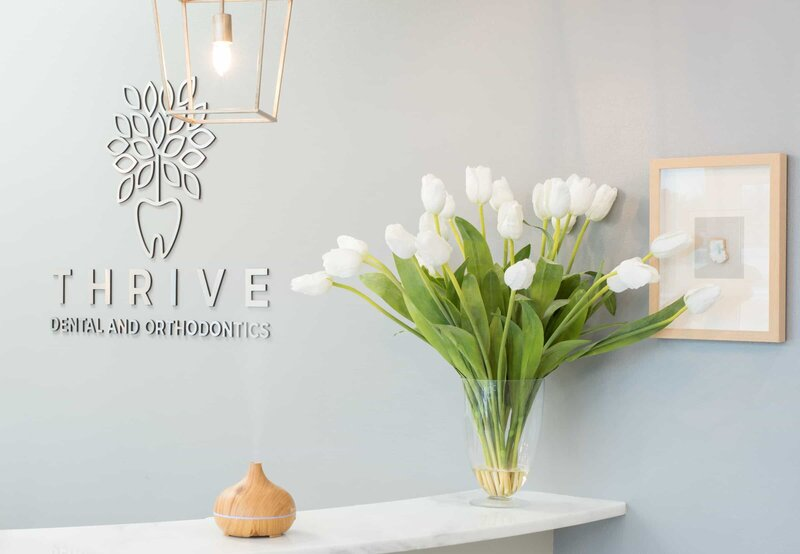 Dental Logo at Thrive Dental and Orthodontics