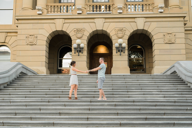 Red Deer Photographers-Raelene Schulmeister Photography- engagement photos-engagement photos on the alberta legislature steps