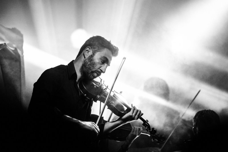 Canva - Greyscale Photography of Man Playing Violin