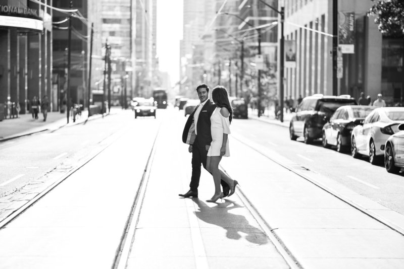 Formal financial district engagement session on Toronto streetcar tracks