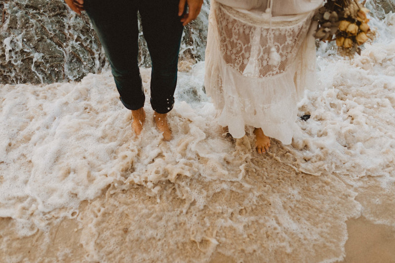 ocean elopement feet in water