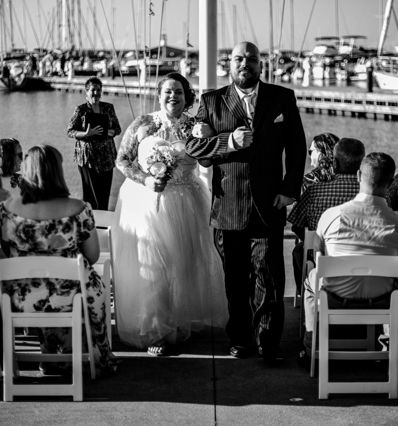 Recessional portrait of bride and groom after their Erie Yacht Club wedding