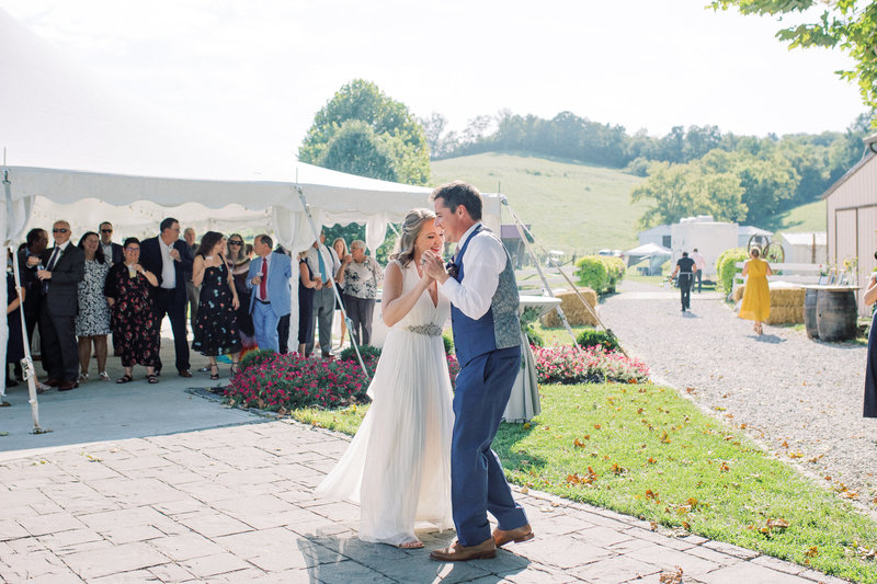 Bride & Groom have first dance outside of reception tent at Neltner's Farm