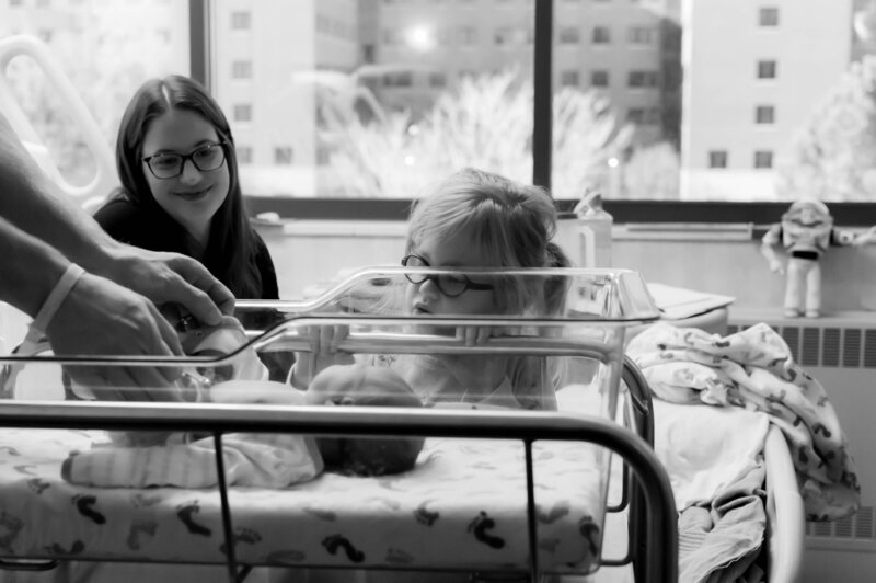 looking at baby in hospital