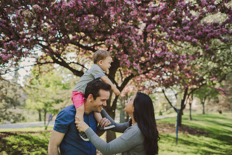 family in apple blossoms