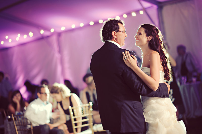 Father and daughter dance in Calgary during an outdoor wedding reception