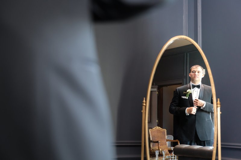 Groom in groom's suite at the Park Chateau