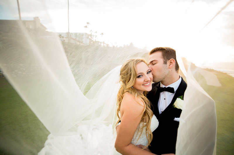 Couple Under Veil in La Jolla During La Valencia Wedding