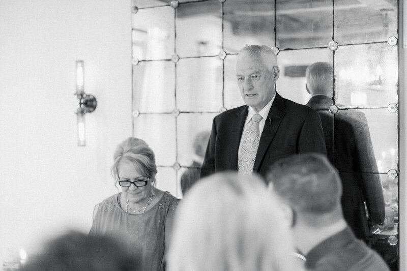 grandfather making speech at candle lit reception dinner at French Inspired Private Estate wedding in charlottesville virginia by costola photography