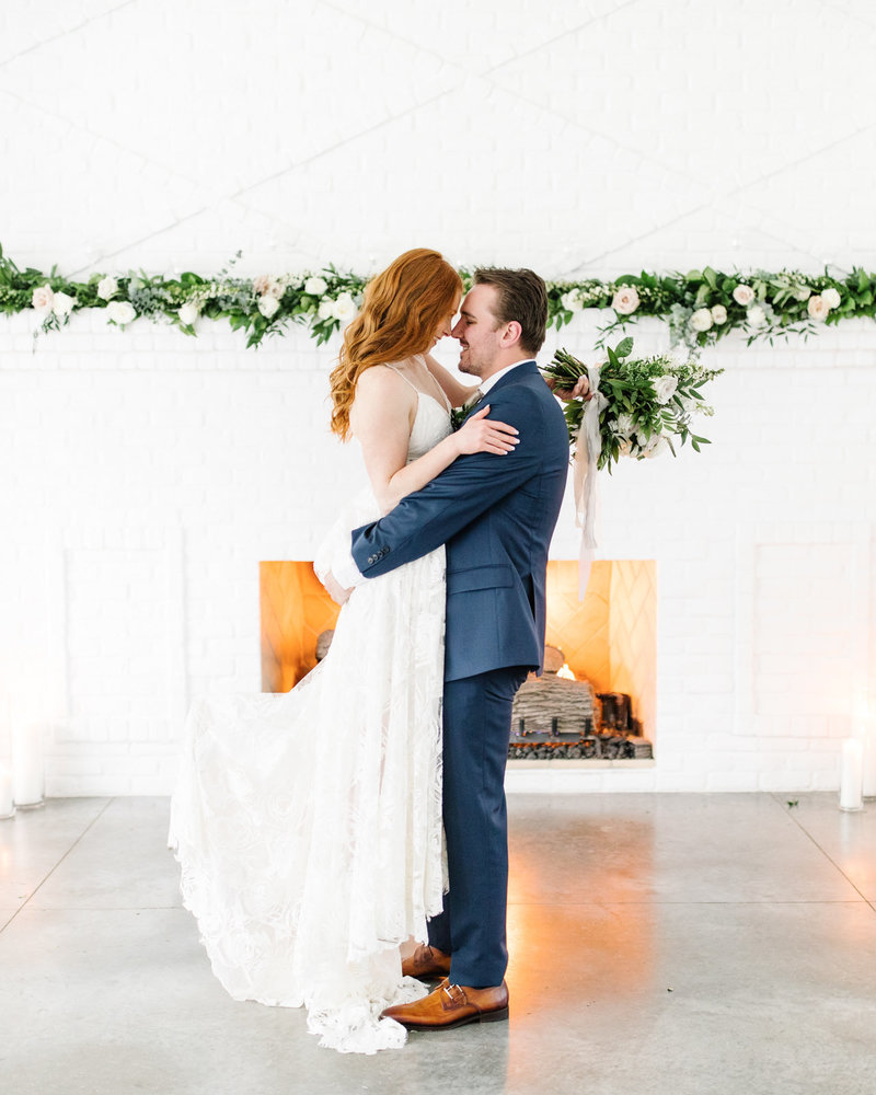 The-Hutton-House-Fireplace-Bride-and-groom-florals-Kiss-Luxury-Wedding