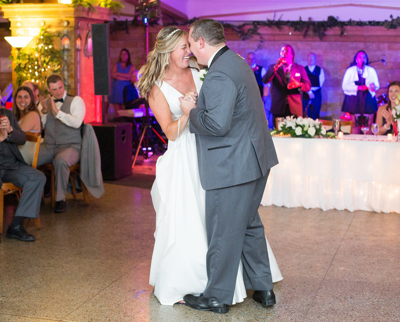 Bride and groom dance first dance at Masonic Temple wedding reception