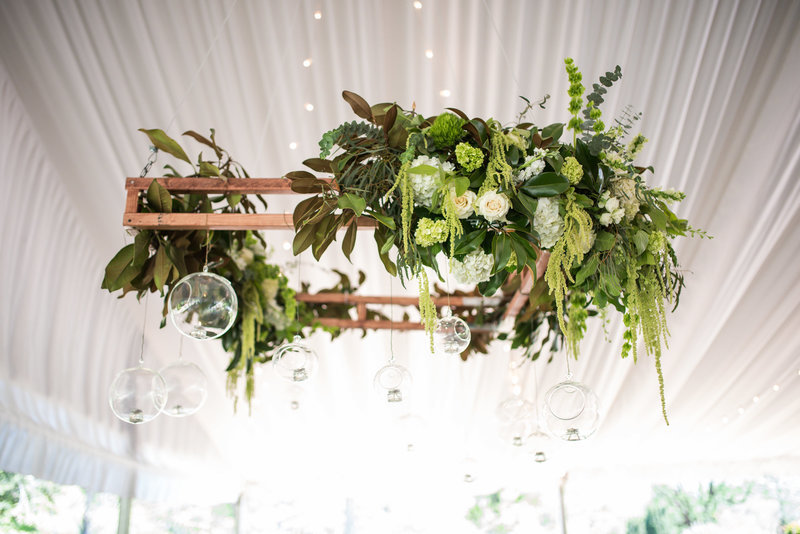 floral wedding chandelier in tent at barnsley gardens