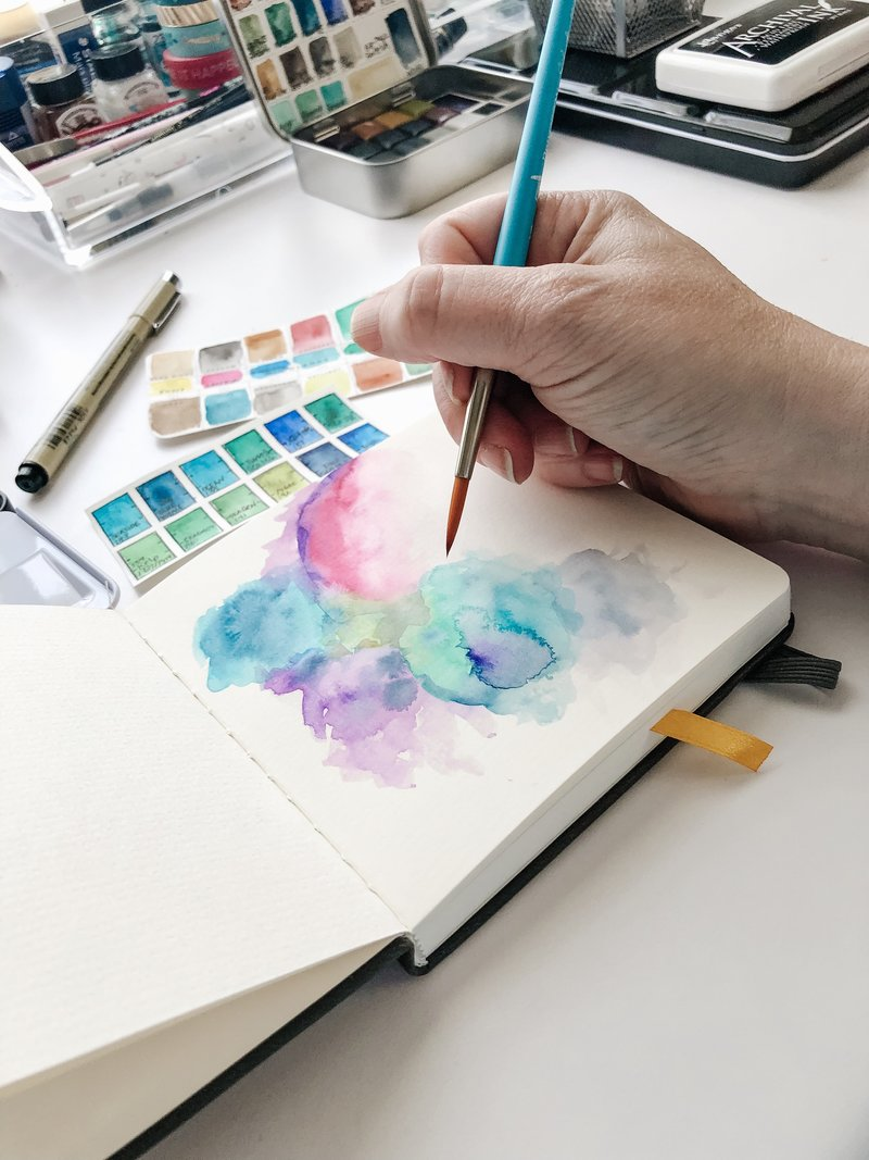 michele painting a colorful watercolor texture