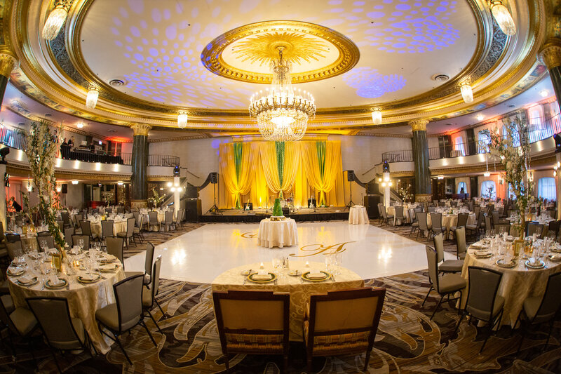 A wedding reception featuring colorful decor, white vinyl dance floor with monogram at the Intercontinental Hotel in Chicago, IL