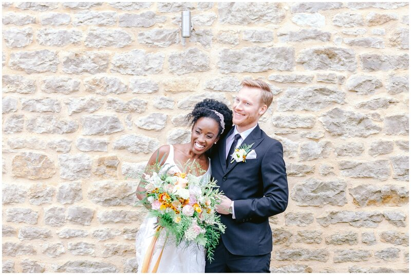 Black bride and white groom in a black tie barn wedding