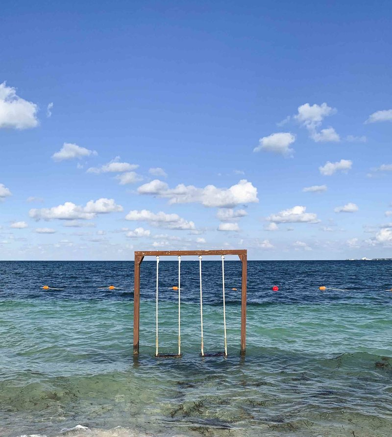 Swings in the middle of ocean in Mexico