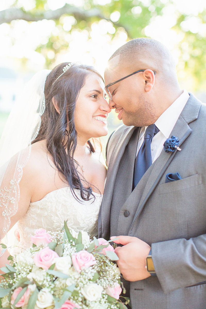bride and groom smiling nose to nose