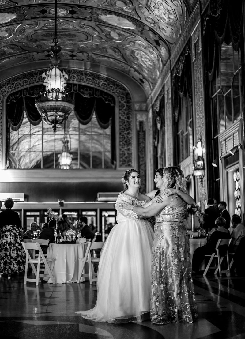 Bride dances with her mother and sister during wedding reception at the Warner Theatre