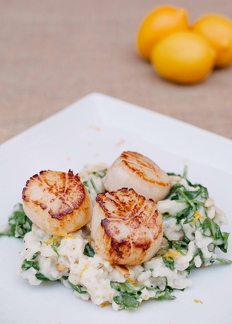 Caramelized scallops with baby arugula pine nut risotto.