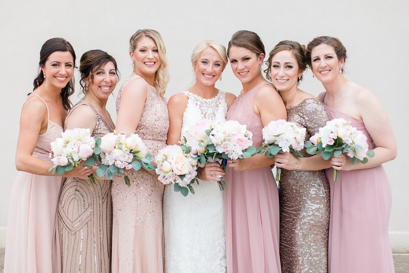 Bridal party in Elegant pink dresses for a  Military Wedding at the Fair Barn in Pinehurst NC